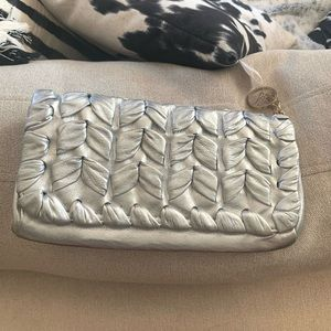 Silver weave Christian Louboutin clutch with charm